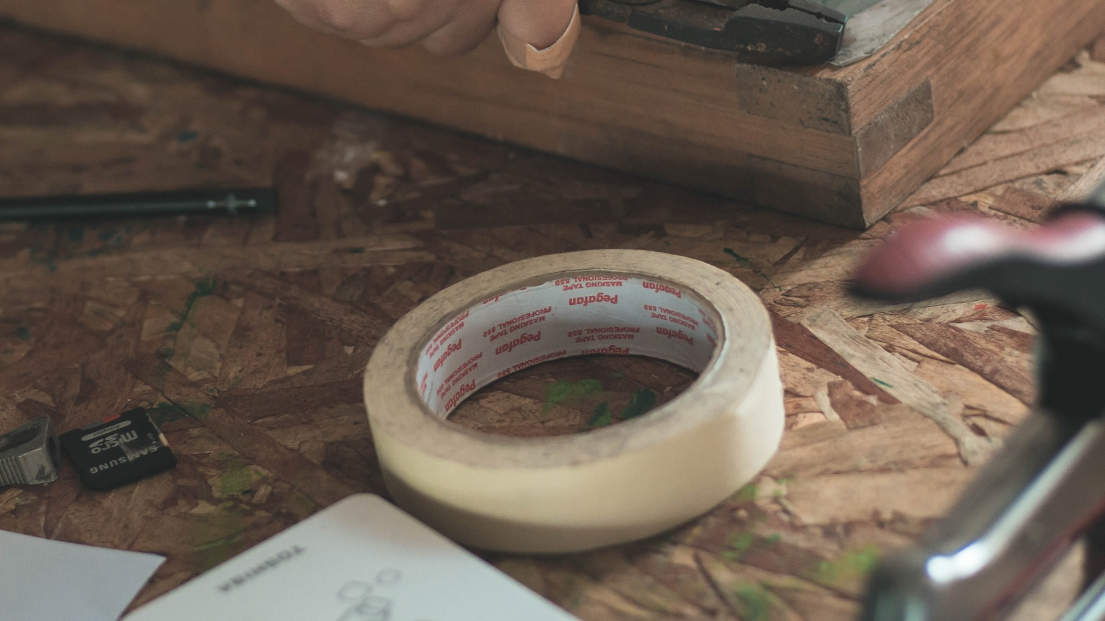 Masking tape lying on a work bench